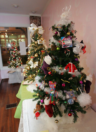 Gloucester: A tree decorated by Stop and Shop includes $10 gift cards hung off the tree for the Cape Ann Symphony's A Festival of Holiday Trees on Main Street. The Cape Ann Symphony will feature a silent auction from November 21 through December 5 of 20 tabletop trees donated by local businesses and people to be on display at 137 Main Street. Mary Muckenhoupt/Gloucester Daily Times