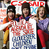 Gloucester: Children hold signs in protest of a new charter school at a hearing of the State Board of Elementary and Secondary Education over it's approval of the Gloucester Charter School at City Hall Saturday afternoon. Pictured, front row, from left, Maisie Grow, Rebecca Dowd and Jemima Grow. Back row, Aidan Cunningham, Matilda Grow and Tess Burnham.  Mary Muckenhoupt/Gloucester Daily Times