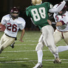 Gloucester: Gloucester's Brandon Cusumano carries the ball past Lynn Classical defenders during the first quarter of the football game at Manning Field in Lynn Friday night. Mary Muckenhoupt/Gloucester Daily Times