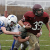 Gloucester: Gloucester's Alessandro D'Angelo gets taken down by Danvers' Shane Tobyne and Corey Walker, left, during the Thanksgving Day game at Newell Stadium. Mary Muckenhoupt/Gloucester Daily Times
