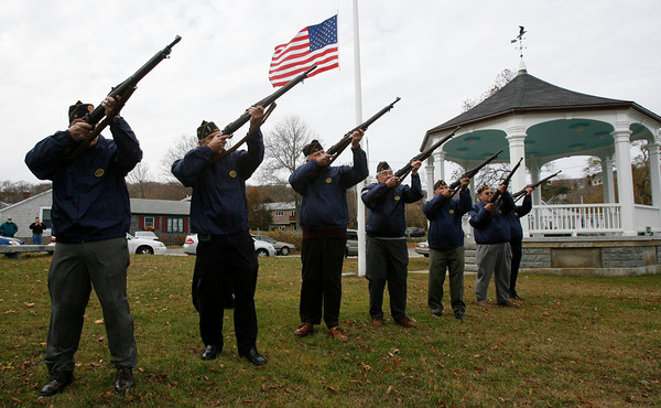 Rockport: Members of the American Legion Post 98 Firing Squad fire three shots before the playing of taps during the Rockport Veterans Day ceremony yesterday. Photo by Kate Glass/Gloucester Daily Times Wednesday, November 11, 2009