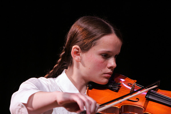 Rockport: Eighth grader Madeleine Downs plays the violin with the seventh and eighth grade string orchestra during the Big Gig Concert at the Lane Performing Art Center at Rockport High School Wednesday afternoon. Mary Muckenhoupt/Gloucester Daily Times