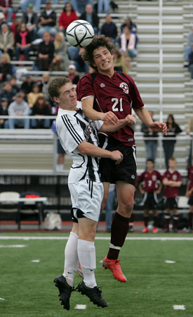 Lynn: Rockport's Chandler Burnham and Weston's Nick Perls jump up to head the ball during the first half of the Division 3 North final at Manning Field in Lynn Sunday afternoon. Mary Muckenhoupt/Gloucester Daily times