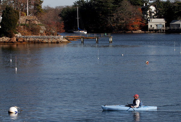Manchester: Rich Brunning of Manchester kayaks along Tuck's Point yesterday afternoon. Photo by Kate Glass/Gloucester Daily Times Tuesday, November 17, 2009