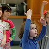 Manchester: Sadie Abramson, a pre-kindergartener from Manchester at the Brookwood School, practices the ballet moves she just learned from April Leichtnam of the Boston Ballet during the Boston Ballet's Art of Ballet Workshop<br /> Tuesday afternoon.  Members of the Boston Ballet came ot the Brookwood School to teach a forty-five minute workshop presentation that introduces dance as<br /> an athletic activity with artistic expression. Mary Muckenhoupt/Gloucester Daily Times