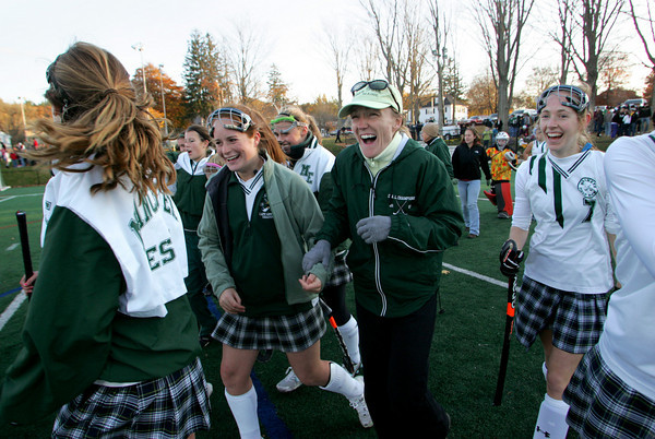 Manchester: Coach Pam Grant celebrates with her team after they won the field hockey tournament against Bishop Fenwichk at Coach Ed Field Field Friday afternoon. Manchetser Essex defeated Bishop Fenwick 1-0. Mary Muckenhoupt/Gloucester Daily Times