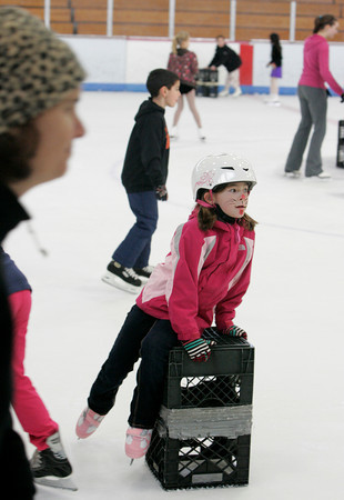 "Gloucester: Sophia Pomeroy, 8, slides by on some milk crates as she waited for her friends to skate over during the Harvest Hoedown Skating Party at Dorothy Talbot Rink Saturday afternoon. The Harvest Hoedown was sponsored by the Cape Ann Skating Club, which offers ""learn to skate programs"" for hockey and figure skaters year-round. Mary Muckenhoupt/Gloucester Daily Times"