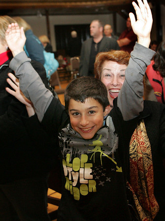 Gloucester: Sefatia Romeo Theken's grandson A.J. Romeo-Oliver, 10, and sister Marianne Paquette celebrates Theken winning councilor at large at City Hall Tuesday night. Theken received more votes than any of her running mates. Mary Muckenhoupt/Gloucester Daily Times