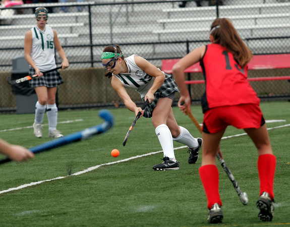 North Andover: Manchester Essex's Patty Wright blasts the ball past Watertown's Alyssa Carlson in the Division II North Field Hockey Championship at North Andover High School yesterday afternoon. Photo by Kate Glass/Gloucester Daily Times Sunday, November 15, 2009