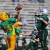 Gloucester: Sam Poliskey of the Riverdale Rockets C-Team gets off a pass over the head of Hornets Cosmo Pallazola, Sunday afternoon at Newell Stadium. Desi Smith Photo/Gloucester Daily Times. November 1,2009.