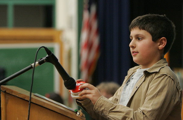 Essex: Nicholas Curcuru presses the Easy Button to let everyone know he locked in his answere while playing Are You Smarter Than A Fifth Grader at Essex Elementary School Friday night. Curcuru helped fifth grade teacher John Skiba come up with another Hawaiian Island to answere the question name two Hawaiian Islands. Mary Muckenhoupt/Gloucester Daily Times