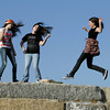Rockport: Kayleen Joubert, Isabella MacKinnon and Rachel Sternlicht rock out to some music while enjoying the nice weather on a wharf near downtown Thursday afternoon. Mary Muckenhoupt/Gloucester Daily Times