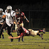 Gloucester: Gloucester's Jordan Shairs makes a diving tackle on Lynn English's Jermaine Patterson  last night at Newell Stadium. Desi Smith Photo/Gloucester Daily Times. October 30,2009.
