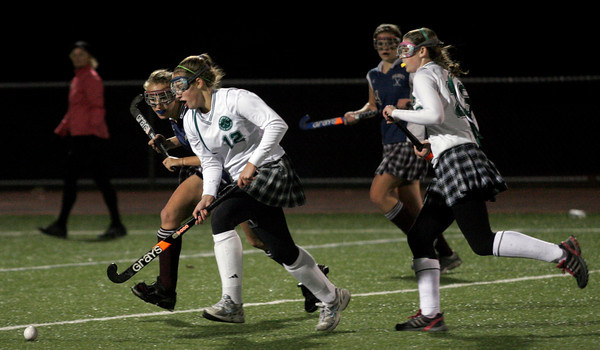 Andover: Manchester Essex's Hannah Daley pushes ahead of Belmont's Abby Ananian as teammate Katie Gavin runs beside her during the Division I North Semifinals at Andover High School last night. Daley scored the only goal in the Hornets' 1-0 win. Photo by Kate Glass/Gloucester Daily Times Wednesday, November 11, 2009