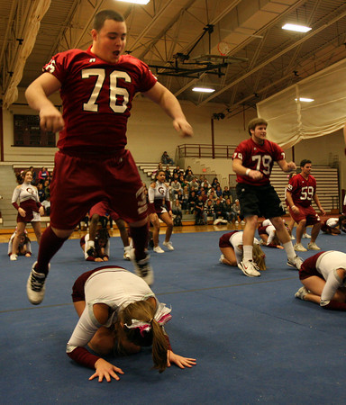 Gloucester: Sal Favaloro, Alex St. Peter, and Max Millefoglie leap over the GHS Cheerleaders during a pep rally in the Benjamin A. Smith Field House yesterday afternoon. Photo by Kate Glass/Gloucester Daily Times Wednesday, November 25, 2009