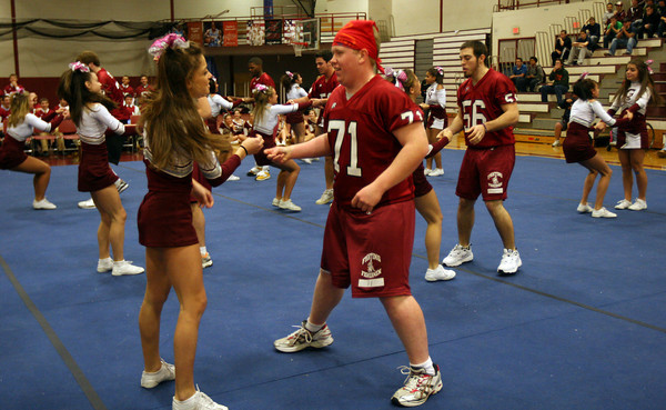 Gloucester: Kyle Jenkins and Ryan Fulford dance with the GHS Cheerleaders during a pep rally in the Benjamin A. Smith Field House yesterday afternoon. Photo by Kate Glass/Gloucester Daily Times Wednesday, November 25, 2009