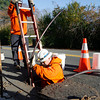 Manchester: National Grid employees install new cables along Summer Street in response to several power outages in the town over the weekend. Photo by Kate Glass/Gloucester Daily Times Monday, November 16, 2009