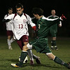 Rockport: Scott Noble manuvers around North Reading's Dan Herman during the soccer game at Rockport High School Tuesday night. Mary Muckenhoupt/Gloucester Daily Times
