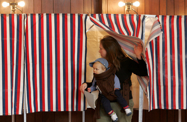 Gloucester: Heather Totty and her son Fionn, 9 months, exit the voting booth at Our Lady of Good Voyage Youth Center Tuesday afternoon. Mary Muckenhoupt/Gloucester Daily Times