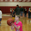 Gloucester: Stephanie Strauss, 9, carefully aims her shot while practicing free throws with her friends during the eighth annual three on three basketball tournamnent at Gloucester High School. The tournamnet is  a fundraiser for the Gloucester High School's DECA and is the program's biggest fundraiser of the year. Mary Muckenhoupt/Gloucester Daily Times