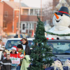 Gloucester: Rick Doucette driving pulls his float Tittled Small Fries from the YMCA Camp Spendrift along Weastern Ave in the Santa Parade Sunday afternoon.The float took home 1st Place.Desi Smith Photo/Gloucester Daily Times. November 29,2009.