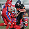 Gloucester: # 29 Cody Harwood of the Hampton Hill Tiger's gets tackled by the Charger's defence Sunday afternoon at Newell Stadium. Desi Smith Photo/Gloucester Daily Times. November 1,2009.