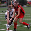 North Andover: Manchester Essex's Hannah Beardsley and Watertown's Alyssa Carlson battle for the ball in the Division II North Field Hockey Championship at North Andover High School yesterday afternoon. Photo by Kate Glass/Gloucester Daily Times Sunday, November 15, 2009