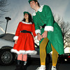 Gloucester:Santa's Helpers  Jessica Maletti and Alex St Peter stop to have their picture taken as they walk along Western Ave in the Santa Parade Sunday afternoon.Desi Smith Photo/Gloucester Daily Times. November 29,2009.