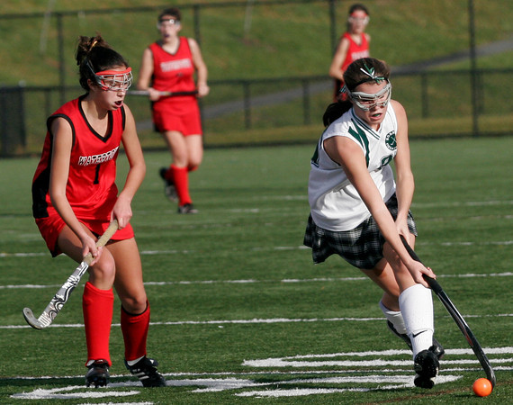 North Andover: Manchester Essex's Amelia Burke maneuvers around Watertown's Jessica Doggett in the Division II North Field Hockey Championship at North Andover High School yesterday afternoon. Photo by Kate Glass/Gloucester Daily Times Sunday, November 15, 2009