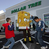 Gloucester: Alex Labelle, 12, left, and Jeffrey Oliveira dance with SpongBob SquarePants as the Dollar Tree Store holds it's grand opening at Gloucester Crossing Saturday morning. Mary Muckenhoupt/Gloucester Daily Times