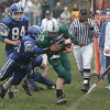 Georgetown: Manchester Essex quarterback Alex Carr is tackled by Georgetown's Ryan Moriarty after getting the first down durign their Thanksgiving game at Georgetown. The Hornets won 22-14. Photo by Kate Glass/Gloucester Daily Times Thursday, November 26, 2009