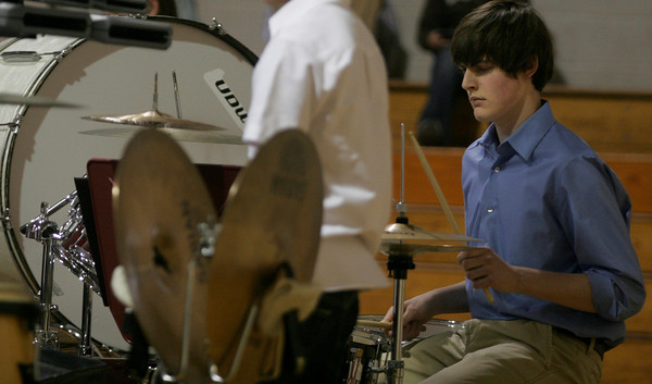 Rockport: Jonathan Perry sight reads the percussion music during the seventh and eighth grade band performance at The Big Gig on Thursday night. Perry, who plays with the high school band, was filling in for one of several performers out with the flu. Photo by Kate Glass/Gloucester Daily Times Thursday, November 5, 2009
