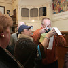 Gloucester: Sefatia Romeo Theken and Jason Grow examine the results from Ward 4-1 with a magnifying glass to see if Grow received 288 or 388 votes. Photo by Mary Muckenhoupt/Gloucester Daily Times Wednesday, November 4, 2009