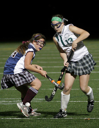 Andover: Manchester Essex's Patty Wright reaches past Belmont's Simmie Steinberg for the ball in the Division I North Semifinals at Andover High School last night. Photo by Kate Glass/Gloucester Daily Times Wednesday, November 11, 2009