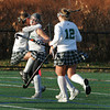 Manchester: Amelia Burke hugs Lizzy Ball as teammates including Hannah Daley, right, congratulate Ball on her goal during the Manchester Essex vs. Bishop Fenwick field hockey tournament Friday afternoon.  Mary Muckenhoupt/Gloucester Daily Times