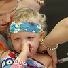 Gloucester: Charlotte Donnellan Valade, 3, of Manchester tries to hold back the tears while receiving her H1N1 vaccine at a flu clinic held at Fuller School Thursday morning.  The Cape Ann Emergency Planning Team has held its second H1N1 Clinic which was open to all children and pregannt women of Cape Ann. Mary Muckenhoupt/Gloucester Daily times