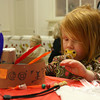 Rockport: Kaelan Mulkern, 2, plays with an Indian headress during Sandy Bay Preschool's Thanksgiving dinner on Tuesday. Photo by Kate Glass/Gloucester Daily Times Tuesday, November 24, 2009