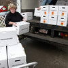 Gloucester: Julie LaFontaine, Executive Director of the Open Door/Cape Ann Food Pantry, and Bill Stevens, manager of the food pantry, unload 100 fully-cooked turkeys that were donated by Stop & Shop yesterday morning for their Thanksgiving meals. The organization will provide dinners for 719 families, and will be able to extend their efforts to 30 more families in Ipswich because of the donation. Photo by Kate Glass/Gloucester Daily Times Tuesday, November 24, 2009