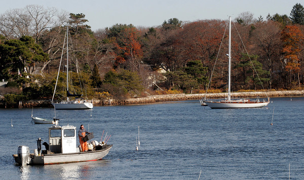 Manchester: Tom Baker of Manchester Mooring removes moorings from around Tuck's Point on Tuesday afternoon as he prepares for winter. Photo by Kate Glass/Gloucester Daily Times Tuesday, November 17, 2009