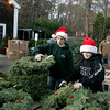 "Manchester: Ryan Grady, 12, left, and Jacob Przesiek, 12, of Manchester Boy Scout troop 3 price and sort Christmas wreaths as the troop holds it's annual Christmas tree sale at the Scout House on School Street Saturday afternoon.  As far as sprices, Przesiek said, "" We have the best prices in seven counties."" Mary Muckenhoupt/Gloucester Daily Times"