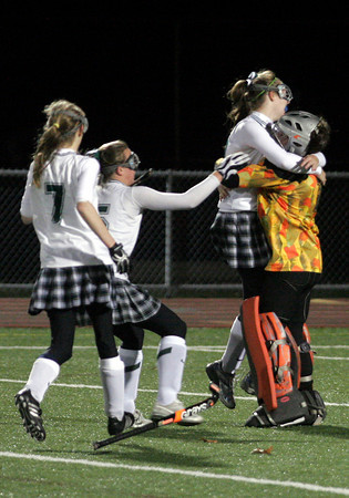 Andover: Manchester Essex's Caroline Moore, Lizzy Ball, and Melissa Moore run to hug goalie Vicky Grimes following their 1-0 win over Belmont in the Division I North Semifinals at Andover High School last night. Photo by Kate Glass/Gloucester Daily Times Wednesday, November 11, 2009