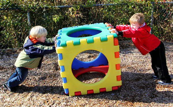 Preschoolers Campbell Berglund, left, and Austin Story test their strength and expend their energy as they push a large plastic cube towards each other in the playground of Rockport Elementary Sccool on Wendesday morning. Jesse Poole/Gloucester Daily Times Nov. 9, 2011