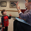 Tommy Dort, 3, of Gloucester, visits the Rockport Public Library on Tuesday morning for the Preschool Story Hour. He counts up to 10 monkeys with volunteer reader and Rockport resident Linda Teahen. Jesse Poole/Gloucester Daily Times Nov. 1, 2011