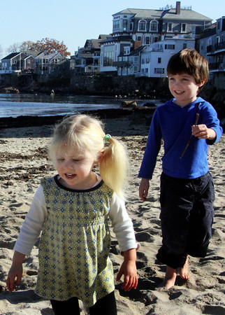Henry Chadbourne, 4, chases his sister, Cecilia, 2, with a stick at Front Beach on Wednesday morning. Jesse Poole/Gloucester Daily Times Nov. 9, 2011