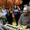 ALLEGRA BOVERMAN/Staff photo. Gloucester Daily Times. Rockport: during the Chorus Summit on Tuesday afternoon at the performing arts center. The Chorus Summit was convened to bring the Madrigals, the high school, middle school and elementary school choruses together for mentoring, fellowship and love of singing. Jim Davison, at piano, was singing along with the choruses.