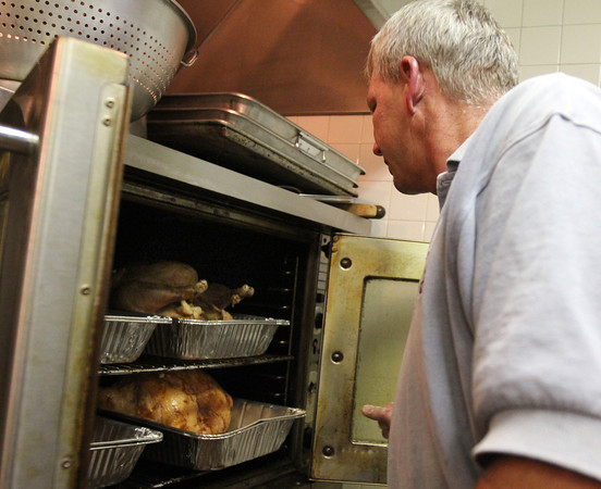 ALLEGRA BOVERMAN/Staff photo. Gloucester Daily Times. Gloucester: John Pasierbiak, an American Legion member and volunteer, has been busy preparing lots of turkeys in advance of Thanksgiving on Wednesday afternoon. By 3 p.m. 15 turkeys had been prepared, each weighing about 22 pounds. The American Legion hosts an annual dinner on Thanksgiving which is free and open to the public at their hall on Washington Street, and pack up and deliver hundreds of full meals to people in the area.