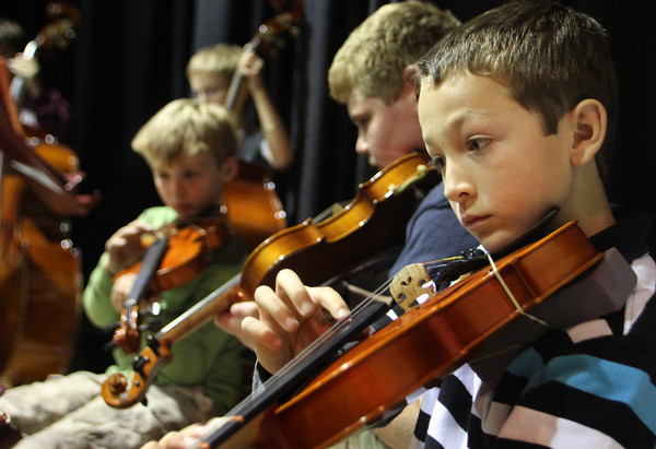 "Fourth grader Walker Knowles, right, plays his violin at the ""Orchestra Summit"" with grades fourth through twelfth in the Performing Arts Center at Rockport Public High School on Wednesday afternoon. Jesse Poole/Gloucester Daily Times Nov. 2, 2011"