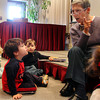 Mesmerized, children gather in front of Linda Teahen, a volunteer reader for the Preschool Story Hour at the Rockport Public Library, as she reads a book involving some rambunctious monkeys on Tuesday morning. Jesse Poole/Gloucester Daily Times Nov. 1, 2011