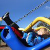 "Billy Nixon, 4, of Gloucester, yells, ""Faster, faster, faster,"" as he swings higher and higher at the Stage Fort Park Playground on Wednesday afteroon. Jesse Poole/Gloucester Daily Times Nov. 2, 2011"