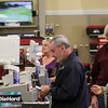 ALLEGRA BOVERMAN/Staff photo. Gloucester Daily Times. Gloucester: Sears employee Dan Kariores, far left, helps Frank and Carol Gray of Rockport, front, as they purchase a dishwasher at Sears on Friday morning.